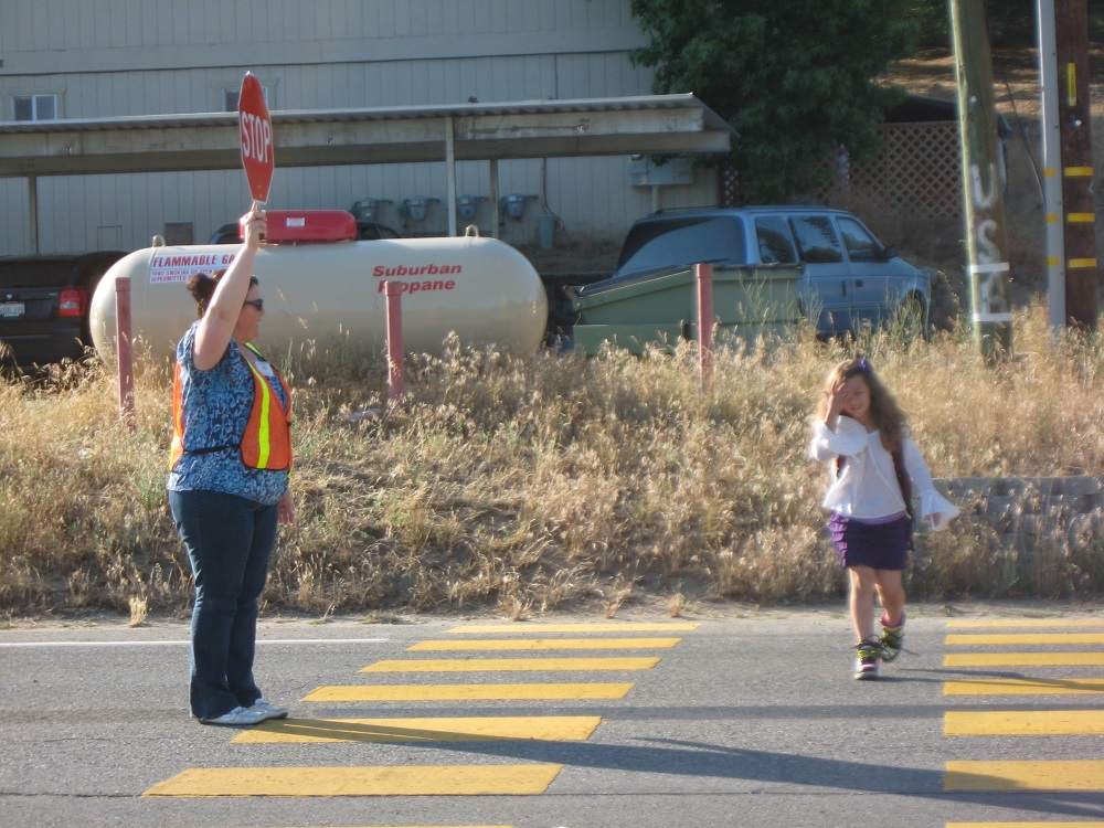 Mrs. Sanchez helps a student arrive safely to Oakhurst Elementary School