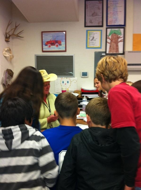 Mrs. Wards Class of 5th graders gather around her and her funny hat! - photo courtesy Mrs. Ward