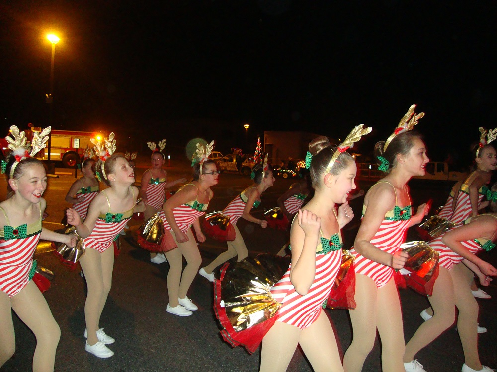 Dancer from Dancers Inc.  Participating in the Rivergold Holiday Fest Parade of Lights - courtesy of Rivergold