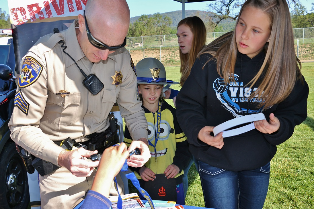 Sgt. OBrien makes CHP hats for the kids