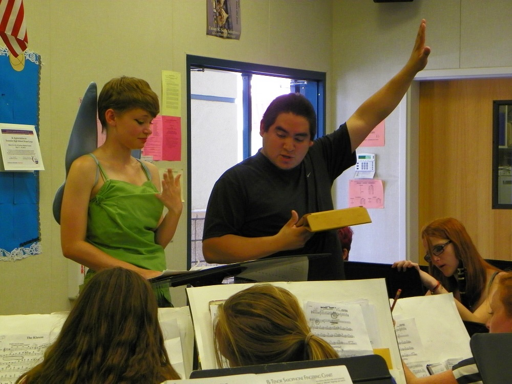 YHS Band Drum Major Meagan Montalto and band instructor Francisco Marquez and members of YHS Badgers Band practice Aug. 2014 - photo by Clara Briley