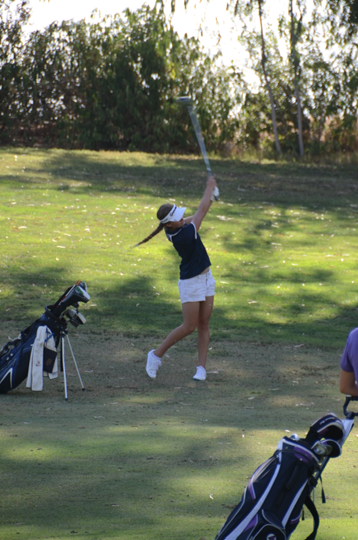 Kelsi hits to the seventh green on Aug 28 against Madera - photo courtesy of Rusty Oetinger