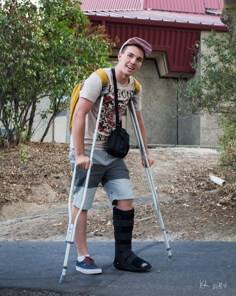 Senior Greg Royce would not let a soccer injury stop him from being on time to the first day of school - photo by Virginia Lazar