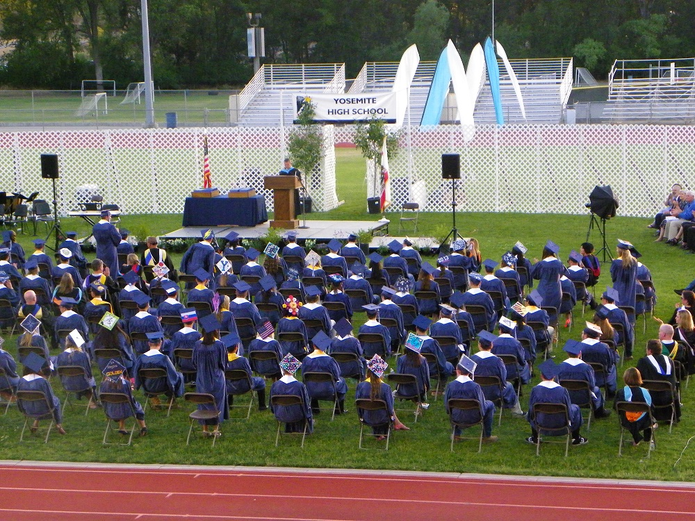YHS Studentsseated on the field for graduation 2013 - Photo by Clara Briley