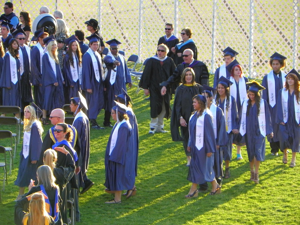 Grads continue filling the field at the YHS Graduation 2014 - photo by Clara Briley