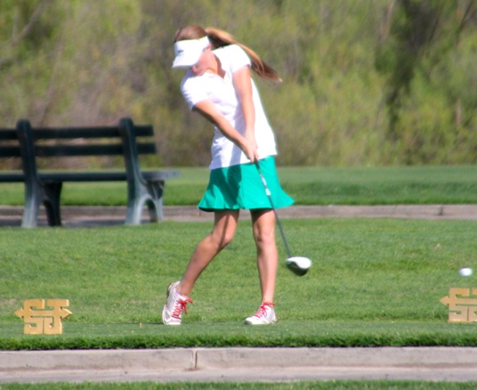 Claire Oetinger hitting a drive - photo courtesy Rusty Oetinger 2014