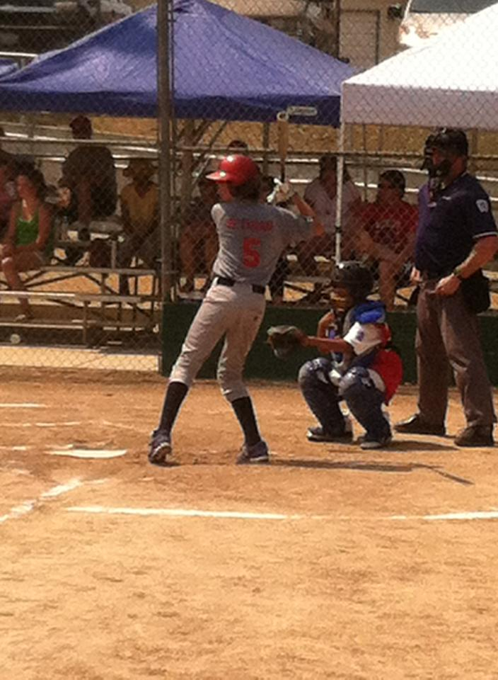 SMLL All Stars team member Ty Peterson sets up for a 2 run homer - photo courtesy Erik Peterson