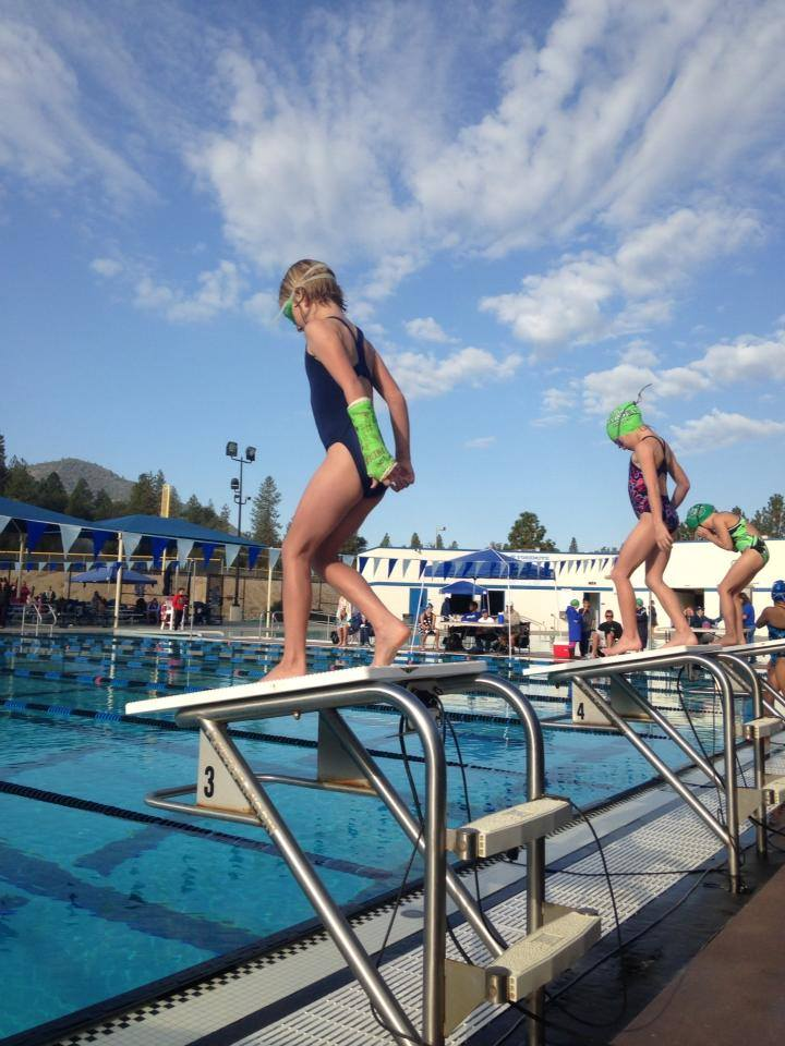 Rocking it with a cast at the YSC home swim meet this weekend. Go girl - photo courtesy Yosemite Swim Club