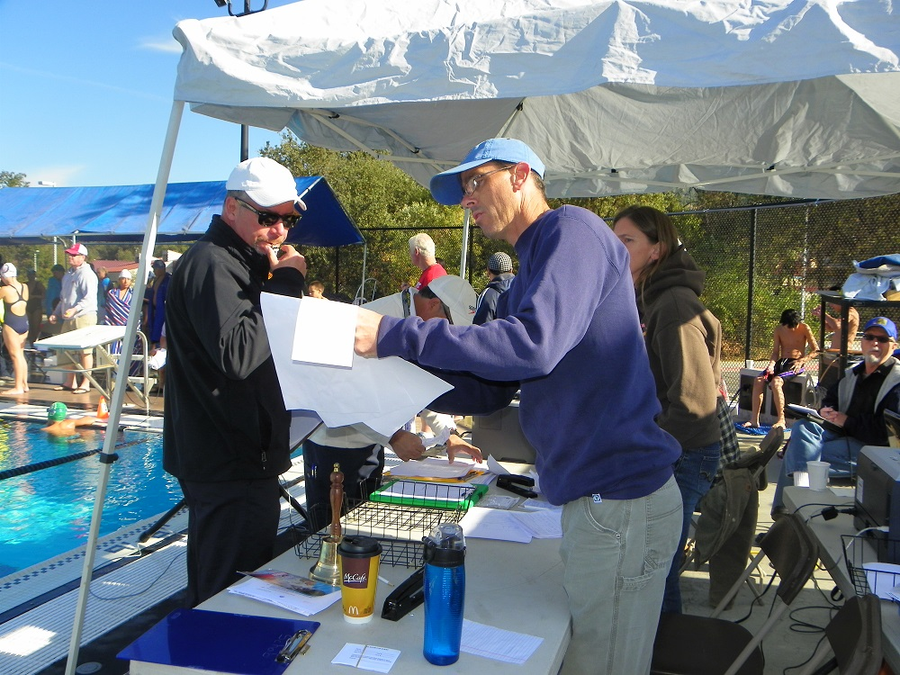 YSC swim meet Oct. 12 2013 - officials check stats - photo by Kellie Flanagan