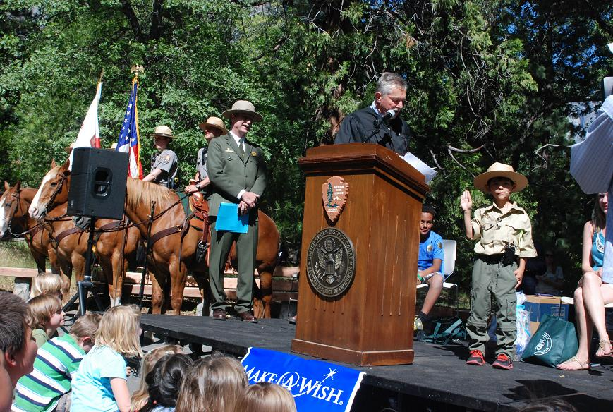 Gabriel Lawan-Ying receives badge and credentials of a Park Ranger - photo courtesy of NPS
