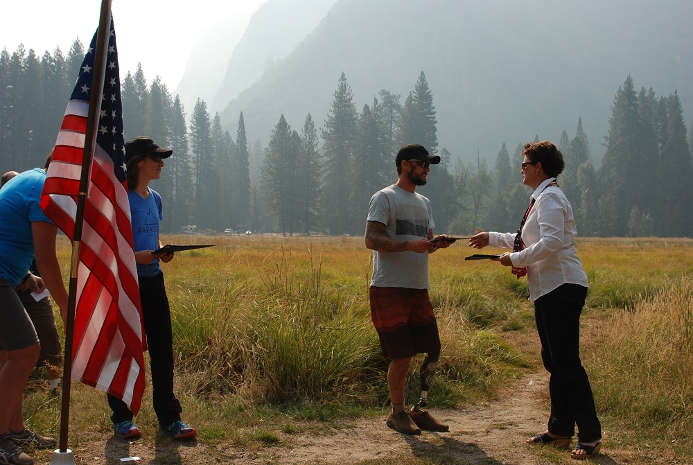 Cody Ellliott, receiving a Certificate of Appreciation from Christina Hall, a Representative of Congressman Tom McClintock, at the Yosemite National Park and Paradox Sports climbing event held in Yosemite Valley - photo courtesy of Yosemite National Park