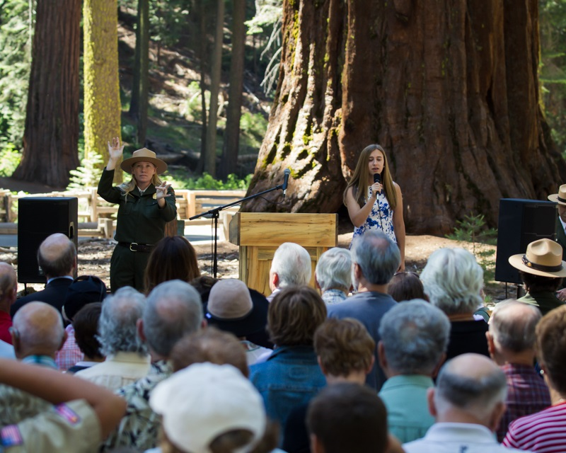 Yosemite Grant Act Anniversary 2014 - YNP Ranger interprets the proceedings in American Sign Language as Emma Boone sings the National Anthem - photo credit Virginia Lazar