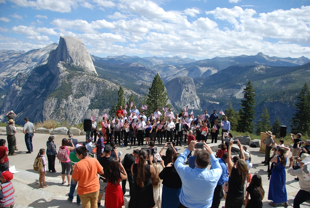 45 new American citizens pose for at the conclusion of a Naturalization Ceremony conducted in Yosemite National Park. Photo courtesy of NPS