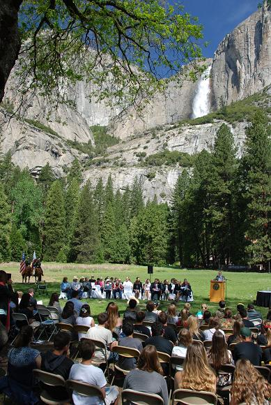 Crowd gathers beneath the falls for Law Day in Yosemite