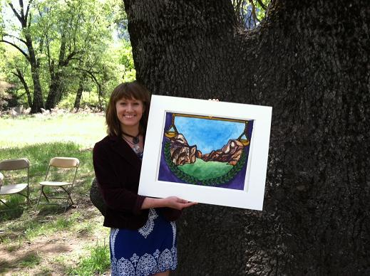 Holly Powell holding her original artwork which was the foundation for the Law Day Yosemite logo