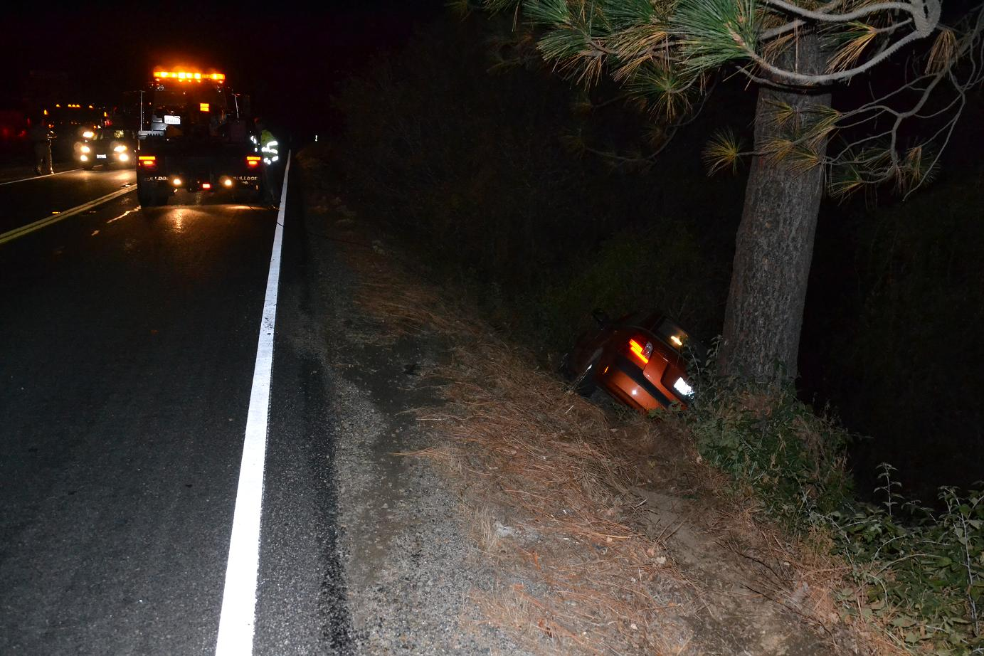 Tow truck and Kia at bear fatality - photo by Gina Clugston