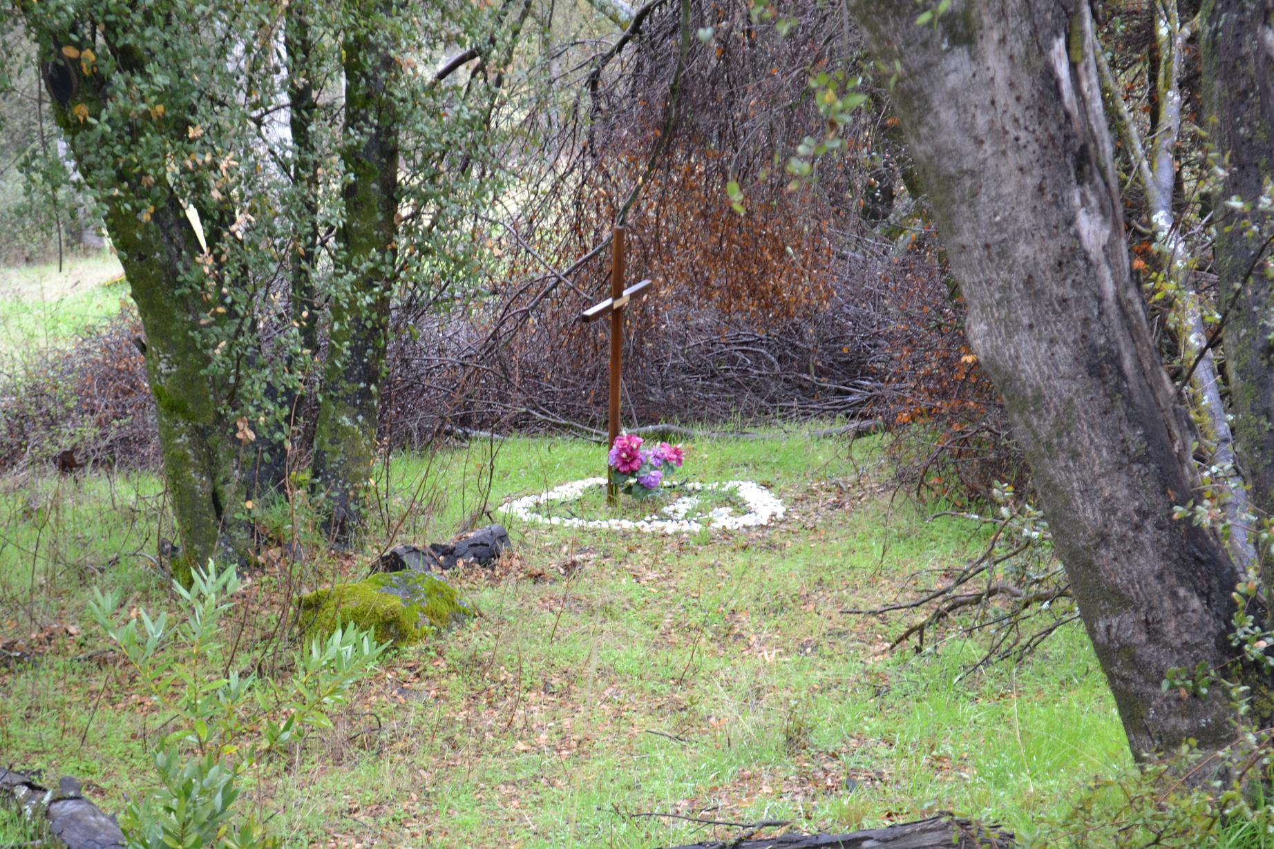 Monument to Ian Raymond Lewis just off the road near accident