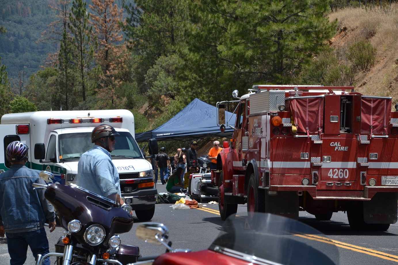 Ambulance and engine at motorcycle crash