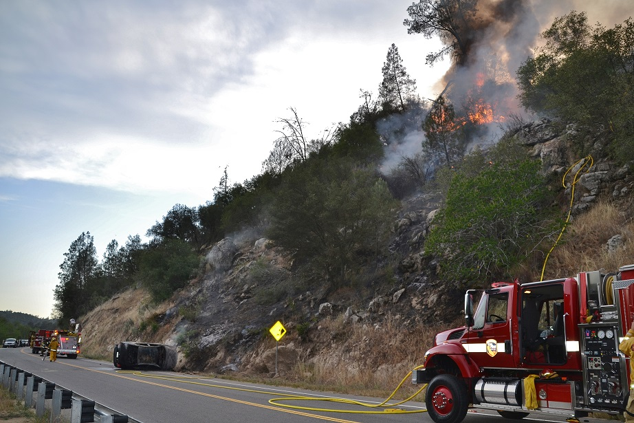 Fire burns above wreck on Road 200 - photo by Gina Clugston Sierra News Online