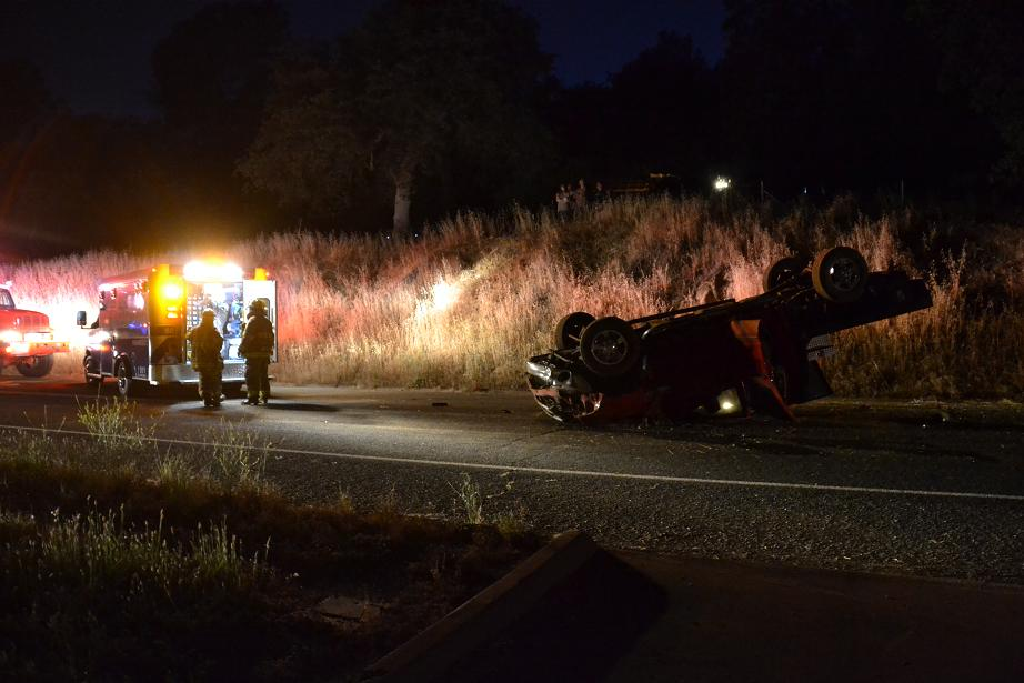 Sierra Ambulance at scene of rollover on Road 200