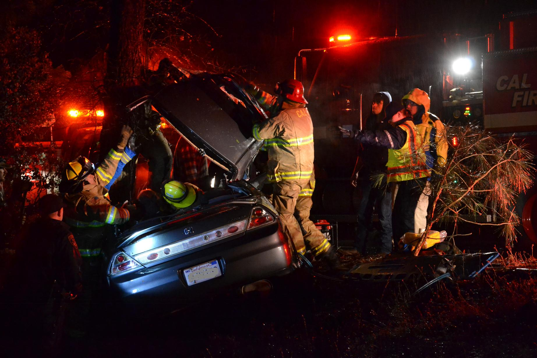 Firefighters cut the top off a Honda to free the driver - photo by Gina Clugston