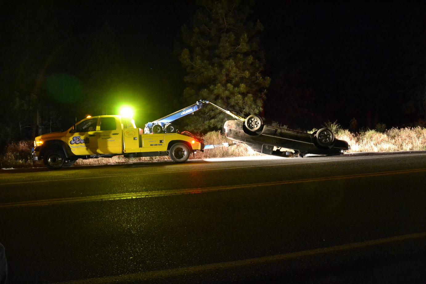 Cadillac upside down on the wrecker