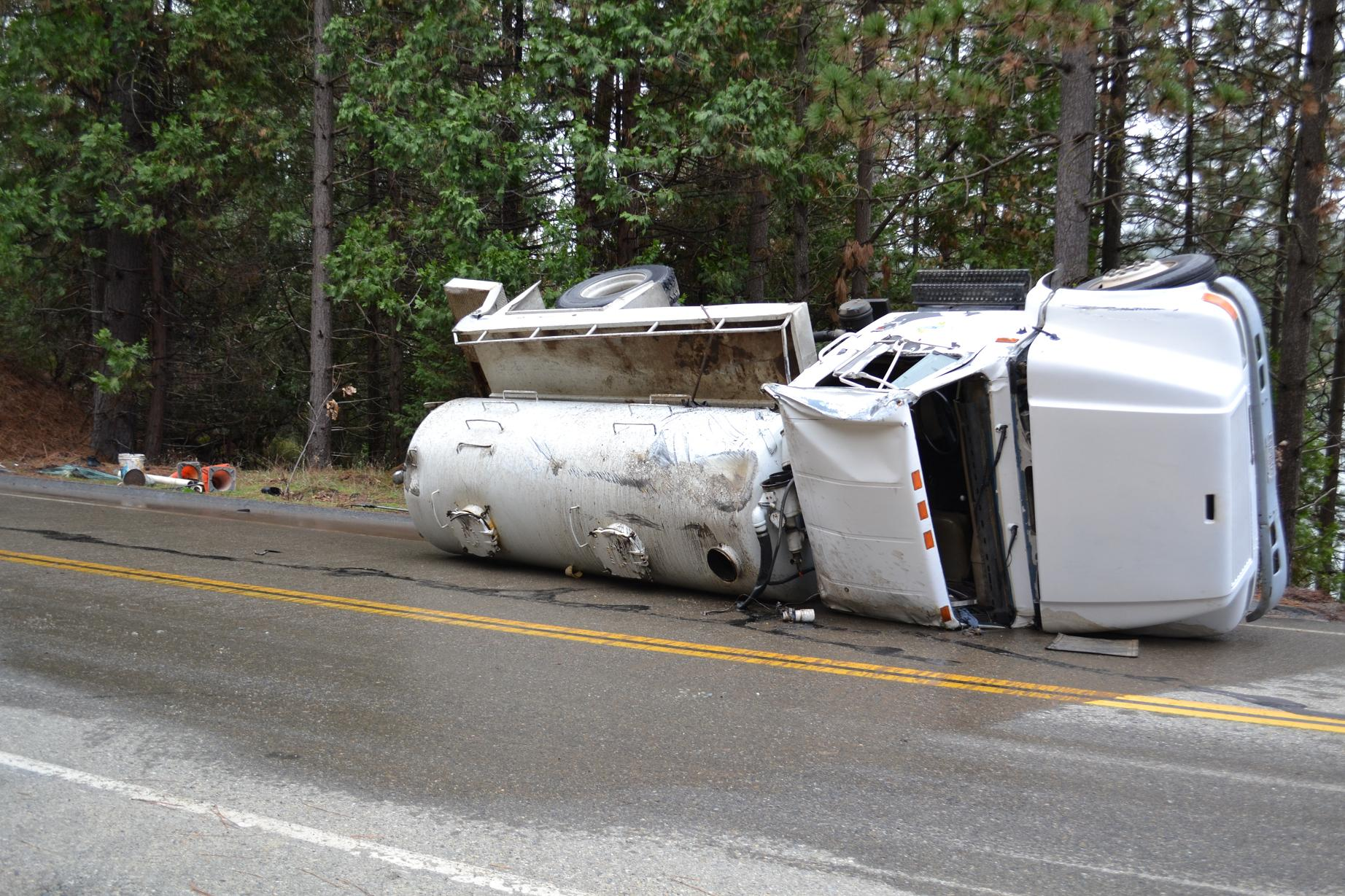 Septic truck turns over near Bass Lake