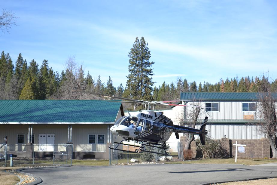 Skylife Helicopter airlifting accident victim from Bass Lake Mini-Storage