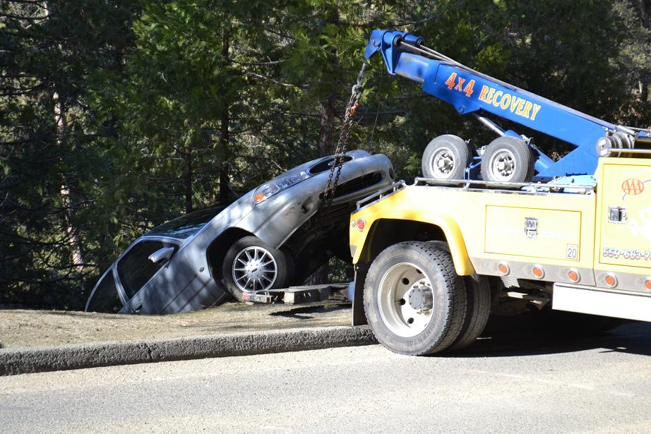 Wrecker pulls Ford up from Willow Creek