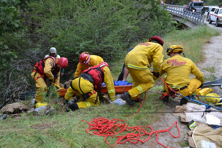 Firefighters hoist litter up out of Willow Creek - photo by Grace DeMasters