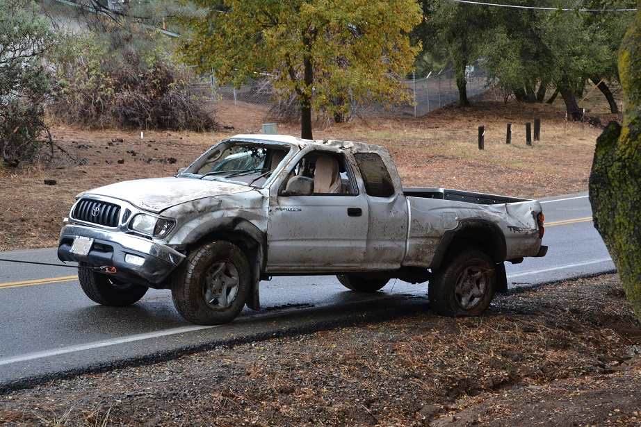 Toyota pickup pulled back onto the roadway