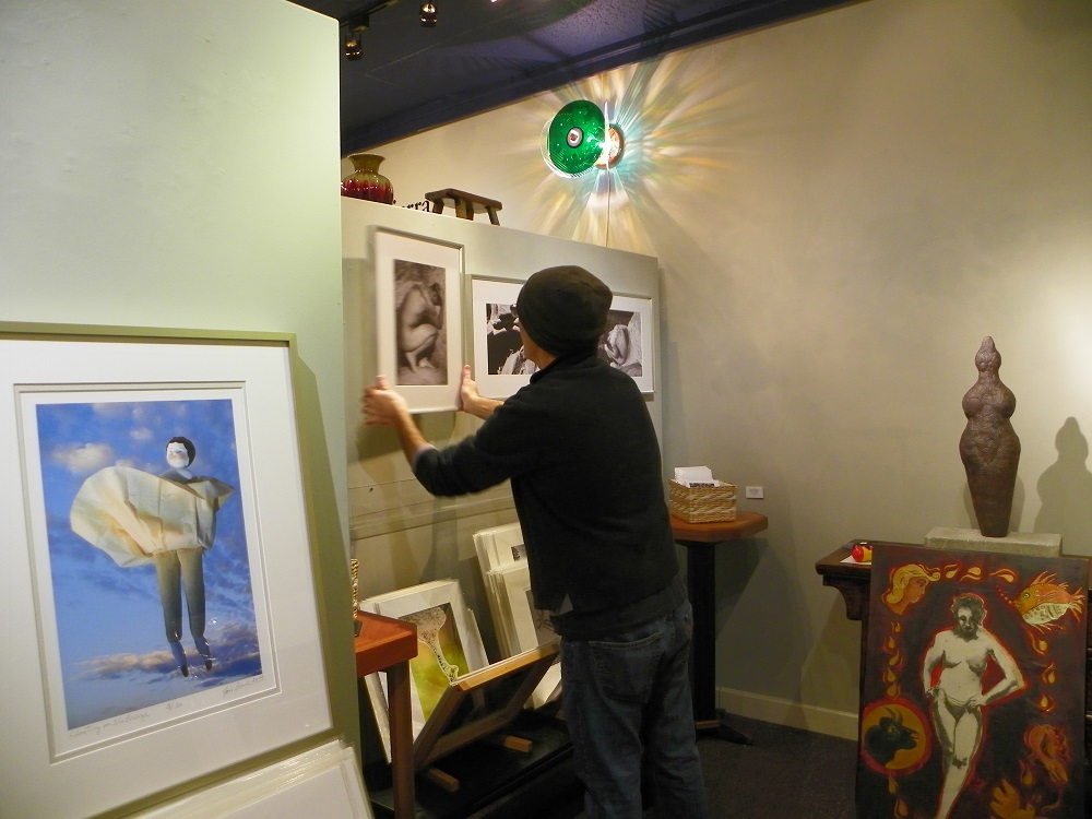 Photographer and artist Michael Costa hangs his work before Stellar Gallery opens The Figure Revealed - photo by Kellie Flanagan Feb 2015