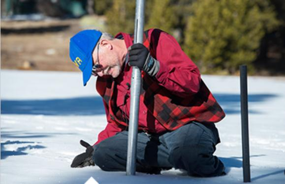 2014 Snow Survey taker - photo Ca Dept of Water Resources