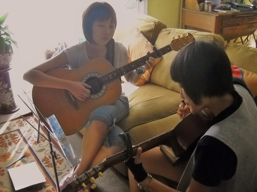 Rene and Holly Play Guitar - Photo by KellieFlanagan