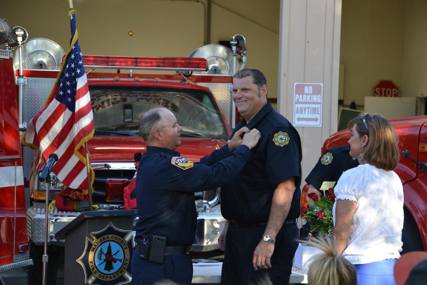 Sean Kelley receives pin from Battalion Chief Christopherson