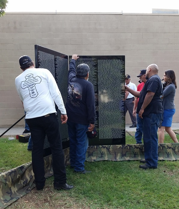 American Legion members assemble the apex of the Moving Wall at Courthouse Park