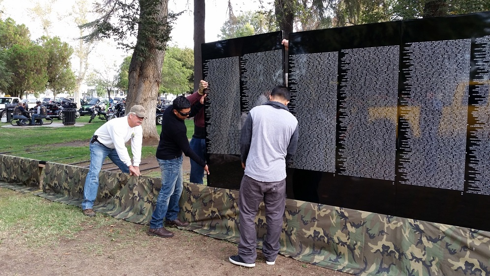 Mountain Vista High School students work with Madera Veterans to assemble the Moving Wall at Courthouse Park