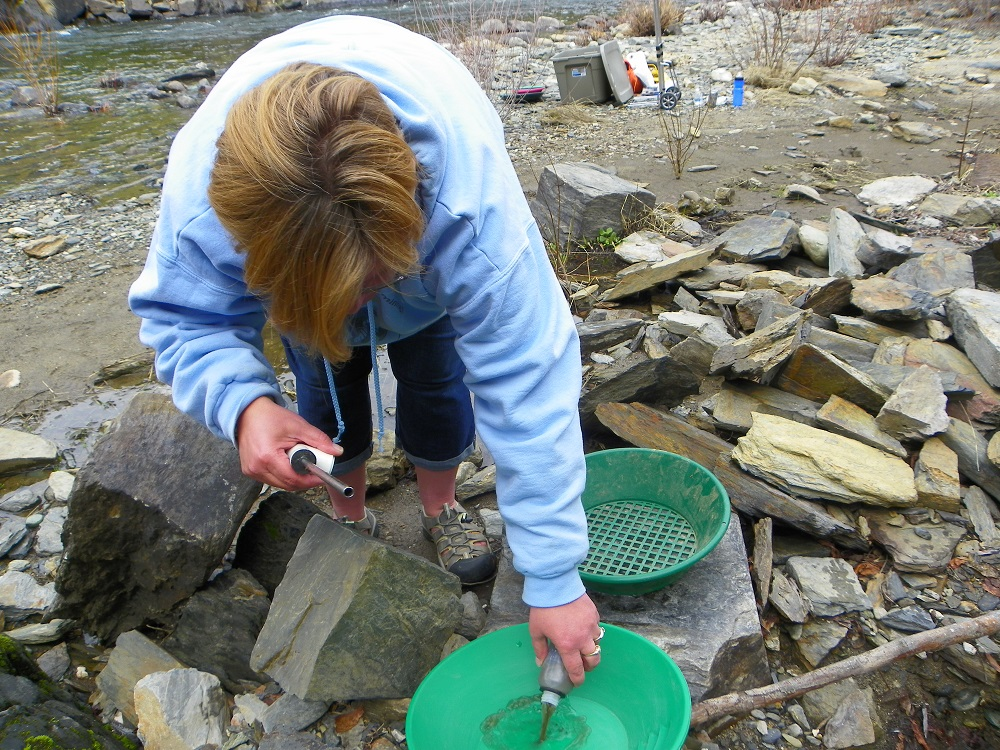 Tamara uses a variety of handheld tools to search for gold in Briceburg along the Merced River - 2014 - photo by Kellie Flanagan