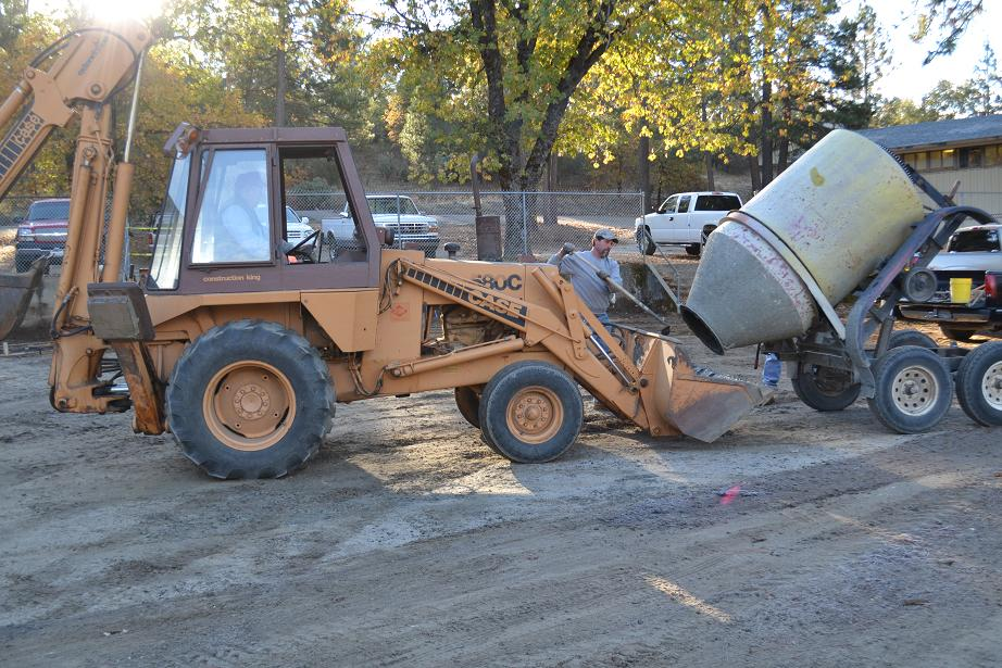 Jon Norby on the backhoe and Tim Allen