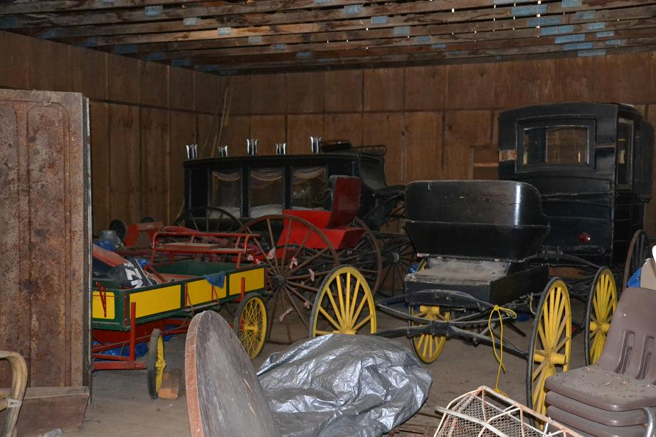 Hearse and Buggy in Livery Stable - photo by Gina Clugston