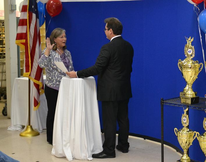 Holly Baker being sworn in as Oakhurst Postmaster 11-16-12