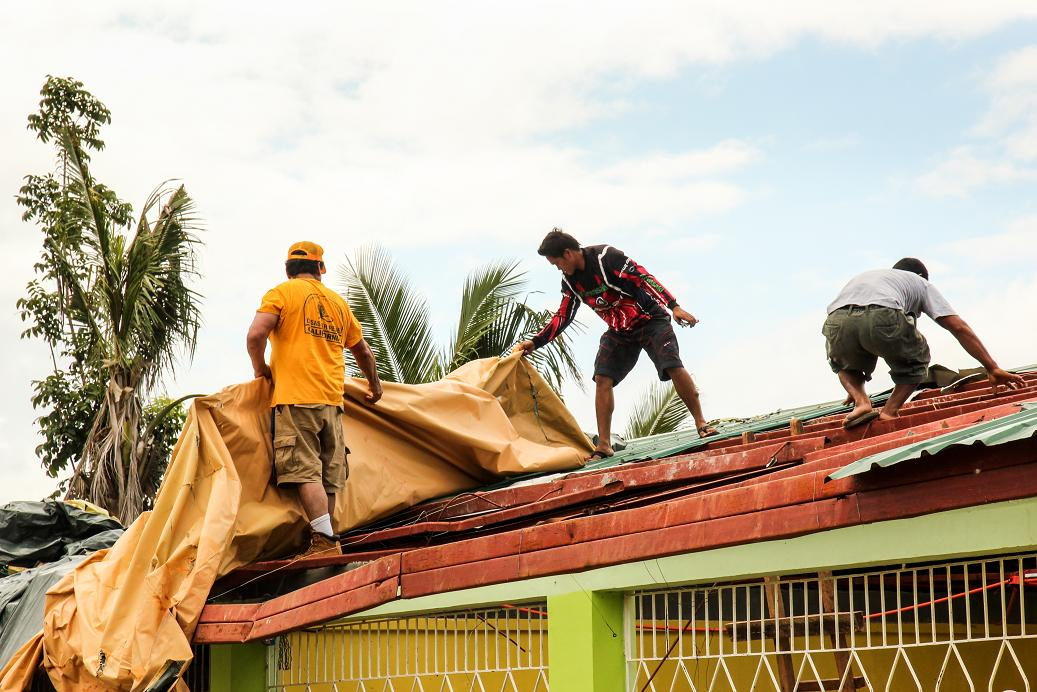 Repairing classroom roofs in the Ormoc area on the west side of the island - photo by Jay York