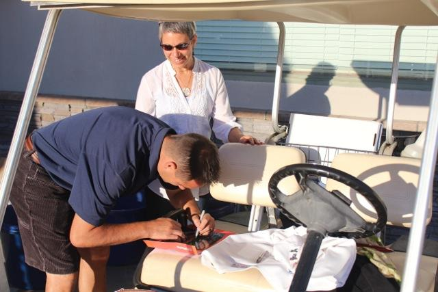 Ted Lilly gives Susan Madden an autograph at the Ted Lilly Golf Tournament 2012