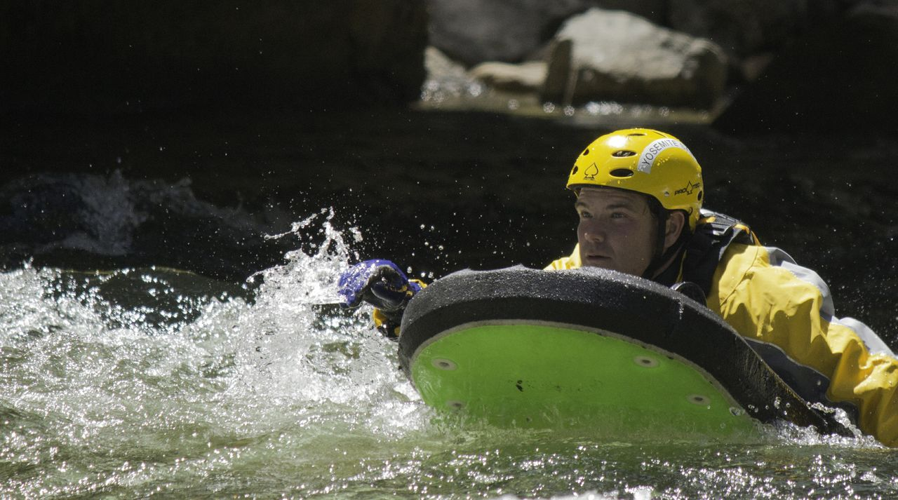 SAR Mike Pope demonstrates swift water rescue technique in Merced River 2013 - Photo by Virginia Lazar