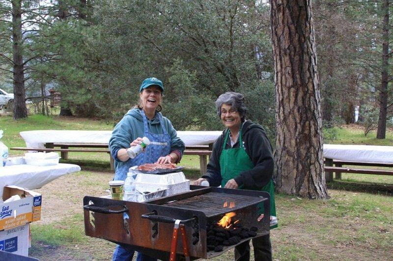 Michelle and Gloria fixing BBQ at Bass Lake Cleanup Day