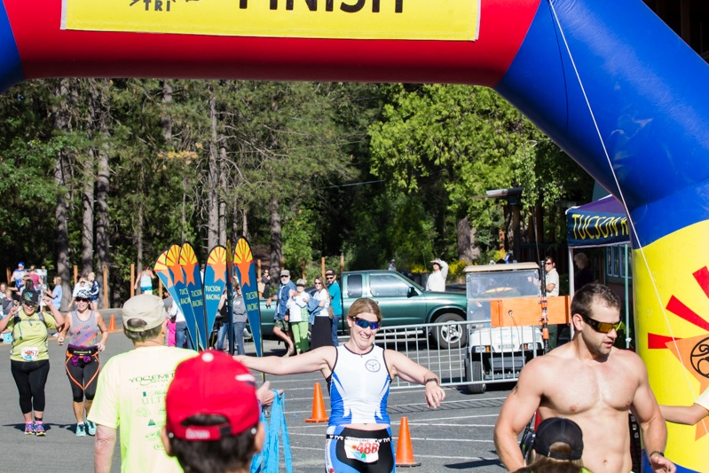 First place finisher for women Lori Olin crosses the finish line at the Bass Lake Classic Triathlon - photo by Virginia Lazar