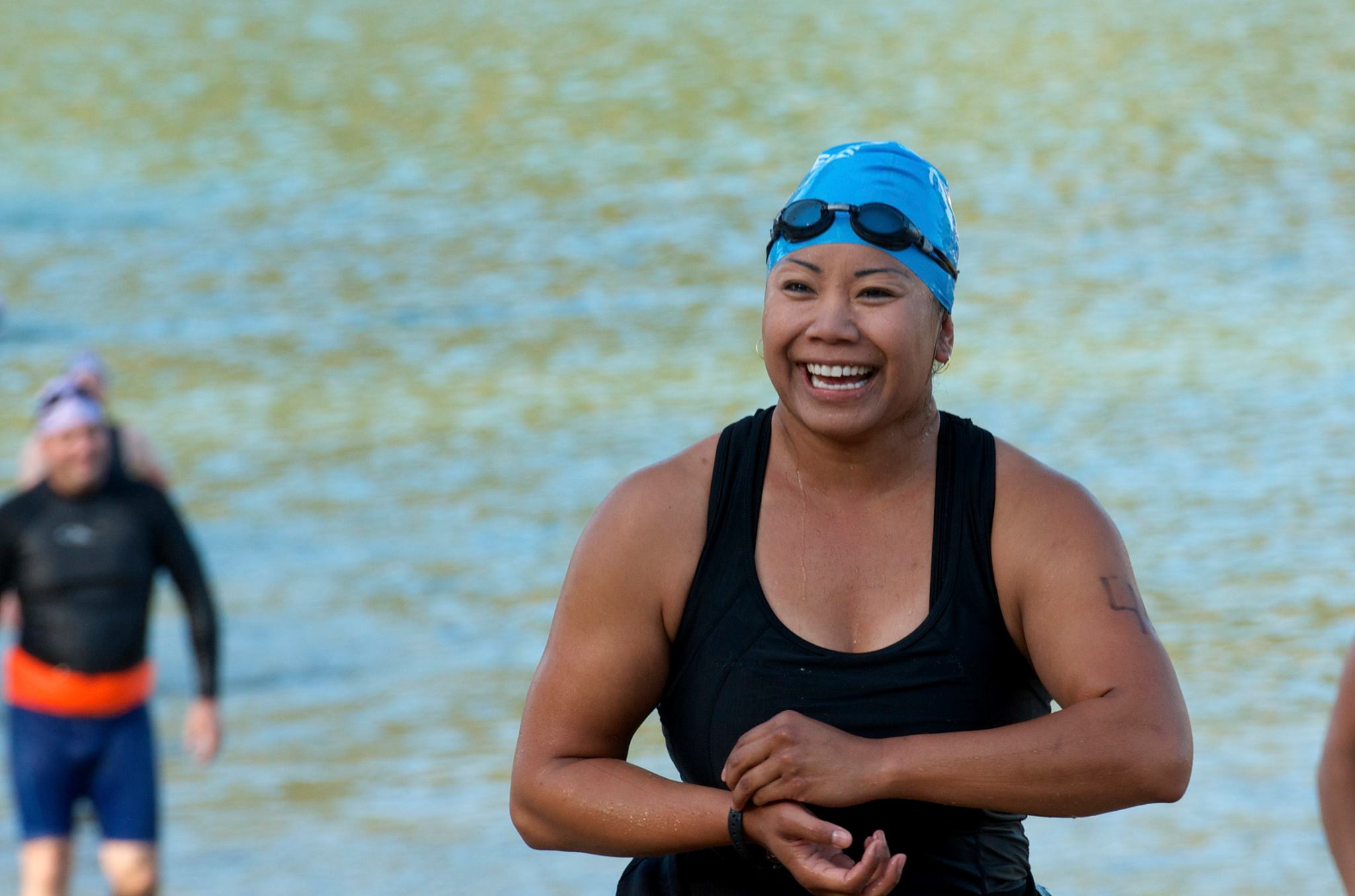 Oakhurst resident Jenny Peter emerges from Bass Lake at the Bass Lake Classic Triathlon 2014- photo by Monique Wales