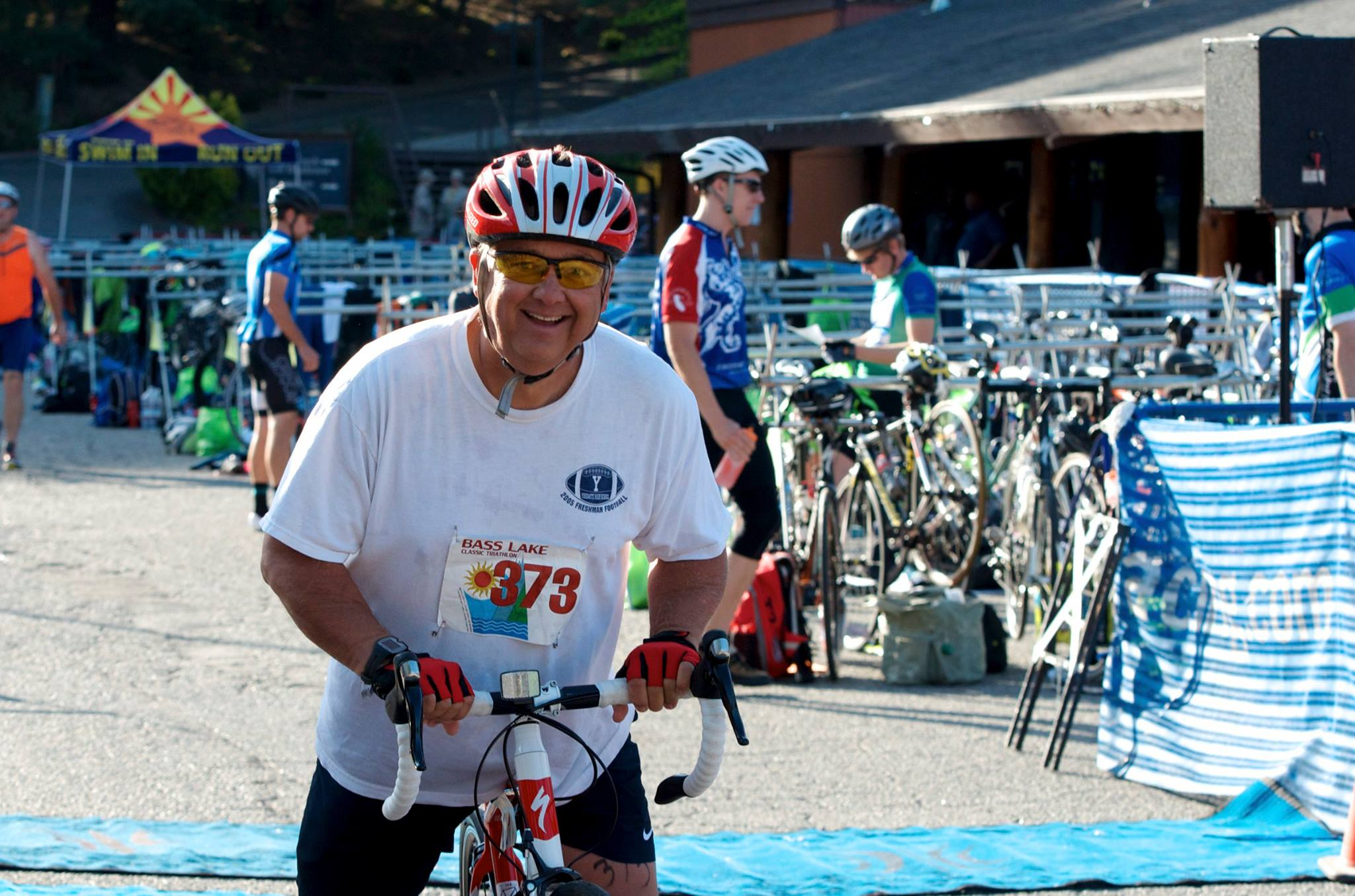 Oakhurst resident and teacher Stan Lawrence on bike at the 2014 Bass Lake Classic Triathlon - photo by Monique Wales