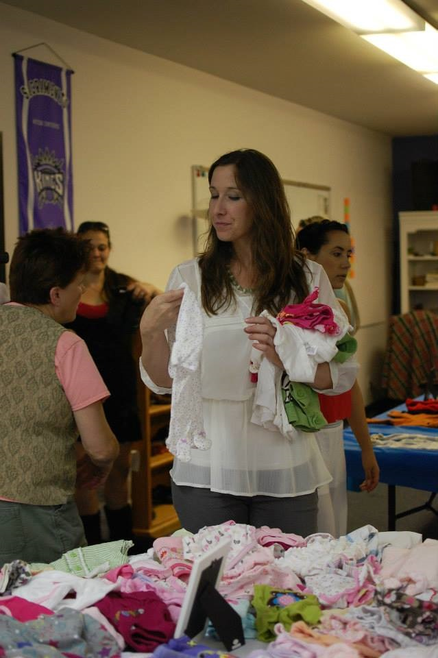 2014 Kim strolling through merchandise at 2014 Community Baby Shower - photo courtesy of MOPS
