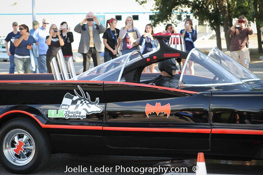 Batman in Batmobile with crowd in bg - Joelle Leder Photography